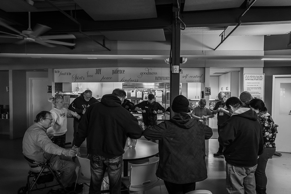Fairfax, Virginia. March 19th 2019 - Homeless people at the lamb center form a circle to offer their final prayers for the day before the center gets closed for the day.