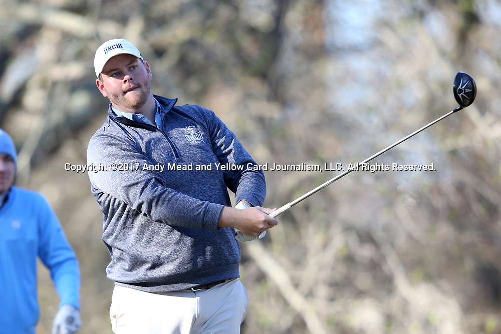 WILMINGTON, NC - MARCH 19: UNC Wilmington's Austin Inman tees off the Ocean Course third hole. The first round of the 2017 Seahawk Intercollegiate Men's Golf Tournament was held on March 19, 2017, at the Country Club of Landover Nicklaus Course in Wilmington, NC.