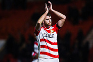 Ben Whiteman of Doncaster Rovers (8) claps the home supporters, after his two goals see his team through during the The FA Cup fourth round match between Doncaster Rovers and Oldham Athletic at the Keepmoat Stadium, Doncaster, England on 26 January 2019.