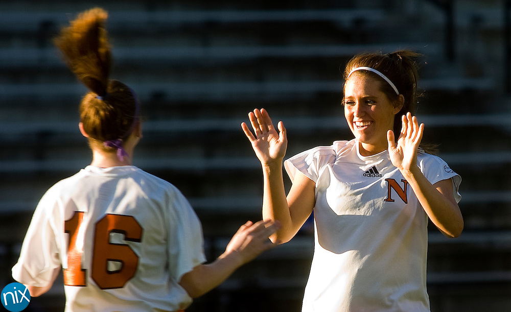 Northwest Cabarrus' Jessica Sellars (16) and Brandi Deal show their excitement after an early Trojans' goal during a 4-1 win over Mooresville Monday night.