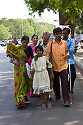 9 year old Manisha who is sighted, leads her blind family members and blind neighbours to the Blind People Association (Andhjan Mandal), Ahmedabad. India