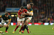 Alex Cuthbert of Wales being hauled down by Lodewyk De Jager of South Africa. Rugby World Cup 2015 quarter final match, South Africa v Wales at Twickenham Stadium in London, England  on Saturday 17th October 2015.<br /> pic by  John Patrick Fletcher, Andrew Orchard sports photography.