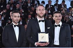 """Vasilis Kekatos, winner of the Best Short Film award for """"The Distance Between Us and The Sky"""" poses with Nikos Zeginoglou and Loko Loannis Kotidis during the photocall for Palme D'Or Winner during the 72nd annual Cannes Film Festival on May 25, 2019 in Cannes, France. Photo by Lionel Hahn/ABACAPRESS.COM"""