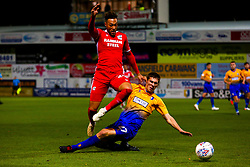 Lewis Gibbens of Mansfield Town tackles Kyle Wootton of Scunthorpe United - Mandatory by-line: Ryan Crockett/JMP - 13/11/2018 - FOOTBALL - One Call Stadium - Mansfield, England - Mansfield Town v Scunthorpe United - Checkatrade Trophy