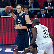 Anadolu Efes's Ermal KURTOGLU (L) during their Turkish Airlines Euroleague Basketball Group C Game 2 match Anadolu Efes between Belgacom Spirou  at Abdi Ipekci Arena in Istanbul, Turkey, Wednesday, October 26, 2011. Photo by TURKPIX