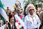 The Cowboy and Indian Alliance (CIA), a group of ranchers, farmers and indigenous leaders, prepare to march from the U.S. Capitol in Washington, District of Columbia, U.S., on Tuesday, April 22, 2014. The groups are hosting an encampment on the National Mall for a week's worth of actions against the Keystone XL tar sands pipeline.