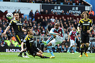 Chelsea's John Terry and Cesar Azpilicueta try to block a shot from Aston Villa's Fabian Delph (c). Barclays Premier League, Aston Villa v Chelsea at Villa Park in Birmingham on Saturday 11th May 2013. pic by Andrew Orchard,  Andrew Orchard sports photography,