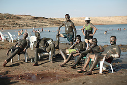 Bathers pose for photos next to the Dead Sea after covering themselves in mud, which is reputed to have beneficial effects for the skin. From a series of photos commissioned by  British NGO, Medical Aid for Palestinians (MAP).