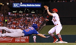 September 26, 2017 - St Louis, MO, USA - The Chicago Cubs' Mike Freeman dives safely into first ahead of the throw to St. Louis Cardinals second baseman Greg Garcia in the fourth inning on Tuesday, Sept. 26, 2017, at Busch Stadium in St. Louis. The Cards won, 8-7. (Credit Image: © Chris Lee/TNS via ZUMA Wire)