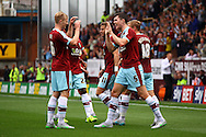Michael Keane of Burnley (r) celebrates with his teammates after scoring his teams 1st goal. Skybet football league championship match, Burnley  v Brentford at Turf Moor in Burnley, Lancs on Saturday 22nd August 2015.<br /> pic by Chris Stading, Andrew Orchard sports photography.