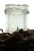 close up of a large old style wine storage and transport bottle