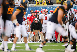 Sep 8, 2018; Morgantown, WV, USA; Youngstown State Penguins head coach Bo Pelini waits on a play during the second quarter against the West Virginia Mountaineers at Mountaineer Field at Milan Puskar Stadium. Mandatory Credit: Ben Queen-USA TODAY Sports