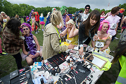 © licensed to London News Pictures. 18/06/2011. London, UK.  Mandatory makeup being applied before the race. Hundreds of men dressed as women take part in The Great Drag Race at Highbury Fields, North London today (18/06/2011). The 10k run is held to raise money for charity and increase the public's awareness of prostate cancer. Photo credit should read Ben Cawthra/LNP