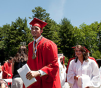 With diploma in hand Scott Ruggieri is ready for the next phase along with his fellow graduates as he departs the 134th Commencement Exercise for Laconia High School Saturday morning.  (Karen Bobotas/for the Laconia Daily Sun)
