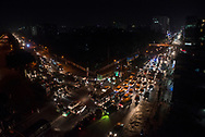 High angle view of a typical traffic jam at night in the crowded streets of Dhaka, Bangladesh. Photo taken at 9pm.