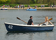 © Licensed to London News Pictures. 06/05/2013. London, UK People enjoy boating on The Serpentine. People enjoy the sunny bank holiday Monday weather today 6th May 2013 in London's Royal Parks. Photo credit : Stephen Simpson/LNP