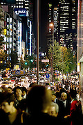 a crowded street with shoppers and business people Shinjuku Tokyo Japan