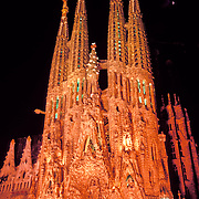 Massive Catholic church under construction in Barcelona Spain designed by architect Antoni Gaudi.  Construction began in 1882 and the current completion date is 2026.