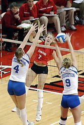 24 November 2006: Jessica Houts blocks a strike by Mary Catherine Richmond during a Quarterfinal match between the Illinois State University Redbirds and the Creighton University Bluejays. The Tournament was held at Redbird Arena on the campus of Illinois State University in Normal Illinois.<br />