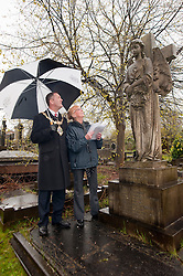 Janet Worrall Secretary of the the Friends of Boston Castle Parkland and Mooregate Cemetery shows the current Mayor of Rotherham, Cllr Shaun Wright, Sir Charles Stoddart's grave. Three times Mayor of Rotherham he Commissioned and Gifted the towns Mace to Rotherham...120627 Mayor tours Mooregate Cemetery..http://www.pauldaviddrabble.co.uk.18 April 2012 .Image © Paul David Drabble