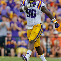 Oct 12, 2013; Baton Rouge, LA, USA; LSU Tigers defensive tackle Anthony Johnson (90) against the Florida Gators during the second half of a game at Tiger Stadium. LSU defeated Florida 17-6. Mandatory Credit: Derick E. Hingle-USA TODAY Sports