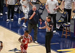 Feb 13, 2021; Morgantown, West Virginia, USA; West Virginia Mountaineers head coach Bob Huggins argues a call during the second half against the Oklahoma Sooners at WVU Coliseum. Mandatory Credit: Ben Queen-USA TODAY Sports