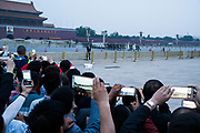 The military ceremony for the dropping of the flag at dusk<br /><br />The well known square at Beijing's historic centre, with the Chairman Mao memorial hall, and entrance to the forbidden city nearby. For us, memories of the massacre at Tiananman square, for the Chinese a place to go and pay hommage to Chairmam Mao. Beijing, China