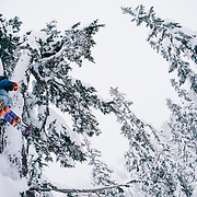 Tyler Hatcher drops an air in the backcountry near Mount Baker Ski Area during a huge winter storm cycle.