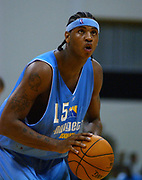 Carmelo Anthony scored 12 points, making 4 of 7 from the field, in his professional debut for the Denver Nuggets in a 112-102 loss to the Los Angeles Clippers in the NBA Summer Pro League, Thursday, July 17, 2003, in Long Beach, Calif.
