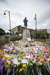© Licensed to London News Pictures. 20/06/2016. Birstall UK. Picture shows the sea of flowers this morning in the market square in Birstall where MP Jo Cox was murdered last week. The man accused of her murder is due to appear at the Old Bailey in London today. Photo credit: Andrew McCaren/LNP