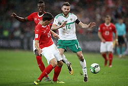 Northern Ireland's Stuart Dallas (right) battles with Switzerland's Fabian Schar (centre) and Denis Zakaria during the FIFA World Cup Qualifying second leg match at St Jakob Park, Basel.