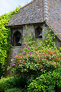 Bells in an old stone building at Stockton Bury Gardens, Leominster, Herefordshire, UK