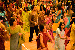 People dancing during the celebration of Navratri; the Hindu festival of Nine Nights,