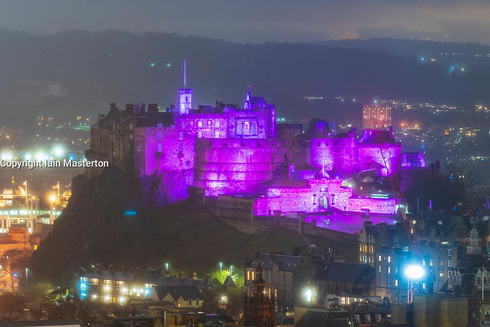 Edinburgh, Scotland, UK. 27 January 2020. Edinburgh Castle is illuminated in purple tonight light as the world marks Holocaust Memorial Day ( HMD). Iain Masterton/Alamy Live News