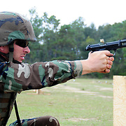 October 17, 2008 -- GULFPORT, Miss. -- A U.S. Navy First Class Petty Officer       trains in handgun marksmanship at Woolmarket pistol and rifle range as part of Expeditionary Combat Skills School (ECS). The ECS school is designed to build a basic level of battlefield competence for sailors from the Navy's newly formed Expeditionary Combat  Combat Command  (NECC) community. The students have a wide range of precision modern warfare skills. Because the Navy is supporting missions ashore more than ever, there is a significant need for sailors to gain land-based combat skills. The aim of the school is to provide NECC sailors basic warfighting and survival capabilities. Photo by Mass Communication Specialist 1st Class Roger S. Duncan.  (RELEASED)
