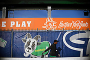 A Hartford Yard Goats employee pulls a cart through the picnic pavilion area in the outfield of Dunkin'Donuts Park before a game in Hartford, Conn.