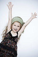 one caucasian beautiful expressive little girl happy smiling raising arms on studio isolated white background
