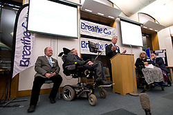 © London News Pictures. 30/04/2013. London, UK. Professor Stephen Hawking (centre) speaking at the launch of a report by the charity Breathe On UK at Portcullis House in London on April 30, 2013. Breathe On UK supports families of children on long-term ventilation. Photo credit: Ben Cawthra/LNP.