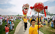 SHOT 7/28/2007 - Shaolin Hung Mei Kung Fu school students lead the procession to the Dotting of the Eyes ceremony at the 2007 Colorado Dragon Boat Festival. Noonan and eight other students manned the dragon which was used as part of the Opening Ceremonies. The sport of Dragon boat racing is over 2000 years old and features teams of 18 paddlers - nine men and nine women plus someone to steer the boat all rowing to the beat of a drum and racing to a flag either 200 or 300 meters away on Sloan's Lake in Denver, Co. Founded in 2001 to celebrate Denver?s rich Asian Pacific American culture, the Colorado Dragon Boat Festival has become the region?s fastest growing and most acclaimed new festival. Festival-goers get to explore the Asian culture through demonstrations, crafts, shopping, eating, and the growing sport of dragon boat racing. .(Photo by Marc Piscotty / © 2007)
