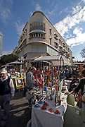 Israel Tel Aviv, The weekly arts and crafts fair, Nachlat Binyamin street. A Bauhaus style building in the background
