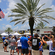 Race fans line up to enter the FanZone prior to the 57th Annual NASCAR Coke Zero 400 stock car race at Daytona International Speedway on Sunday, July 5, 2015 in Daytona Beach, Florida.  (AP Photo/Alex Menendez)