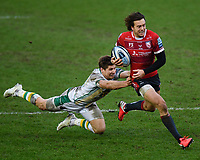 Rugby Union - 2020 / 2021 Gallagher Premiership - Gloucester vs Northampton Saints - Kingsholm<br /> <br /> Gloucester's Lloyd Evans evades the tackle of Northampton Saints' Piers Francis.<br /> <br /> COLORSPORT/ASHLEY WESTERN