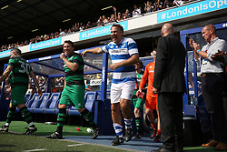 2 September 2017 - Charity Football - Game 4 Grenfell - Paul Merson of team Ferdinand jokes with the opposition as they exit the tunnel - Photo: Charlotte Wilson