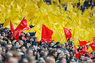 Watford fans waving their flags during the The FA Cup semi-final match between Watford and Wolverhampton Wanderers at Wembley Stadium, London, England on 7 April 2019.