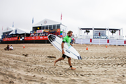 Frederico Morais of Portugal placed second in Heat 11 and advanced into Round Four at The VANS US Open of Surfing in Huntington Beach, CA, USA