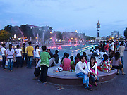Sunday evening in one of Phnom Penh's many public parks. many families meet in the park and spend the Sunday off enjoying each other's company. A light show and music play according the water fountain.