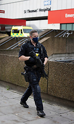© Licensed to London News Pictures. 13/10/2020. London, UK. Armed police are seen outside St Thomas' Hospital after an incident which is believed to now be contained. Photo credit: Peter Macdiarmid/LNP