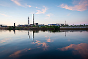 Sunset over an abandoned Soviet factory on the outskirts of Arkhangelsk, Russia.