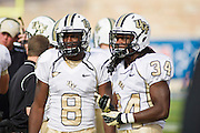 Dec 1, 2012; Tulsa, Ok, USA; University of Central Florida Knights running backs Storm Johnson (8) and Brynn Harvey (34) talks on the sidelines during a game against the Tulsa Hurricanes at Skelly Field at H.A. Chapman Stadium. Tulsa defeated UCF 33-27 in overtime to win the CUSA Championship. Mandatory Credit: Beth Hall-USA TODAY Sports