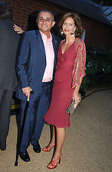 TRINNY WOODALL and her husband JONNY ELICHAOFF at the Cartier Chelsea Flower Show dinat the annual Cartier Flower Show Diner held at The Physics Garden, Chelsea, London on 23rd May 2005.<br />